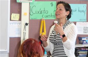a Spanish teacher talks to her class