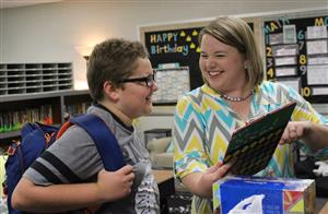 a teacher talks to a student at meet the teacher night