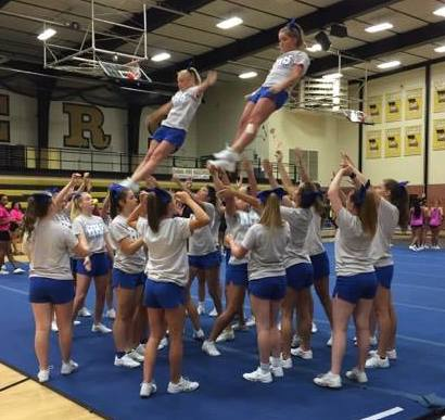 cheerleaders perform a stunt at camp