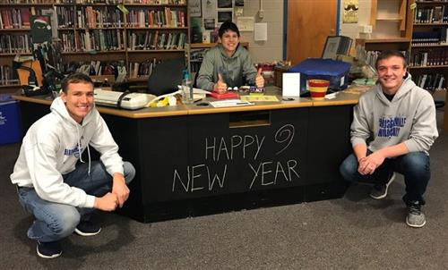 karsen and friends pose with chalkboard-painted circulation desk