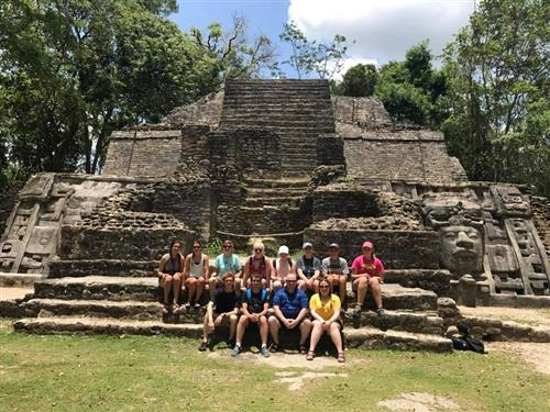 wildcats post in Belize in front of a ruin