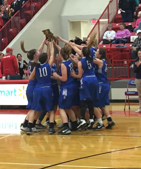 girls basketball celebrates a district title